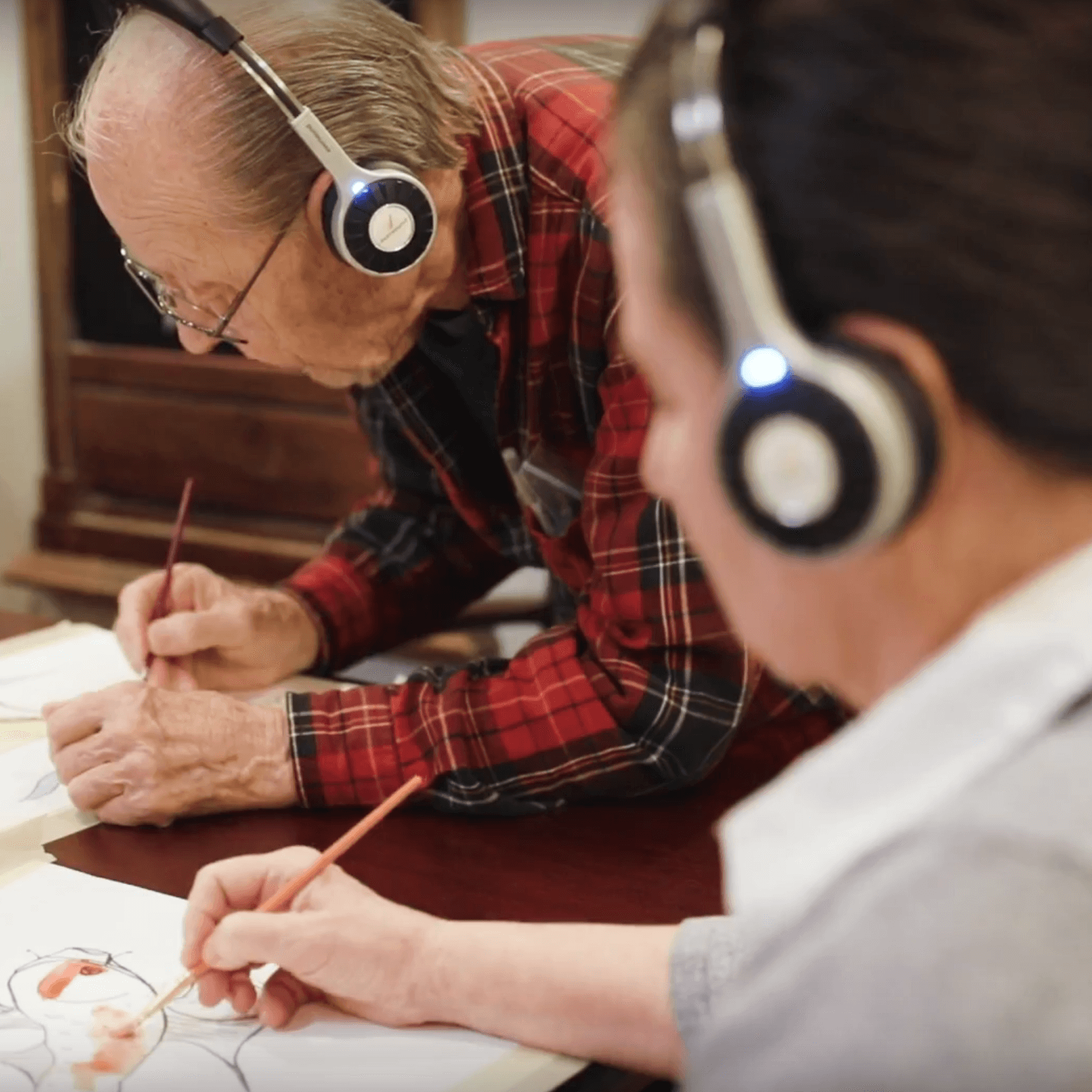 Senior residents painting while listening to music with Eversound