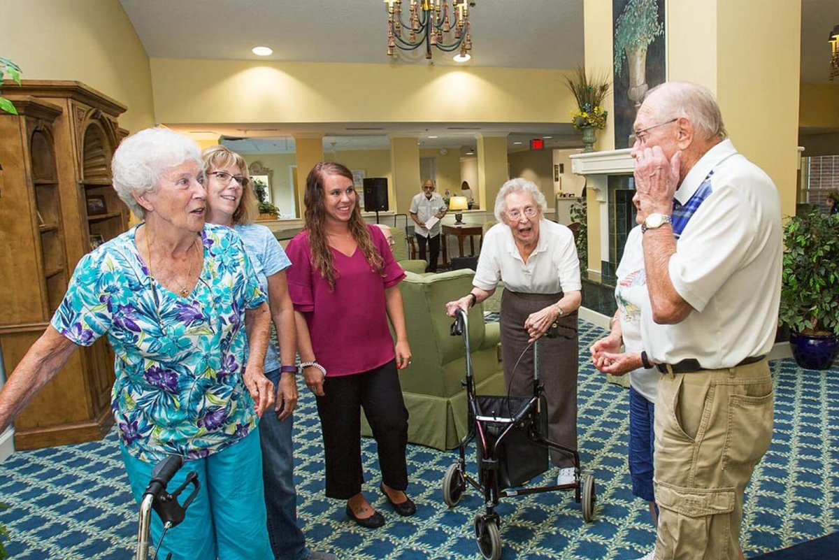 storypoint seniors laughing with activities director