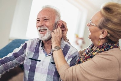 Older man with hearing aid slowing cognitive decline