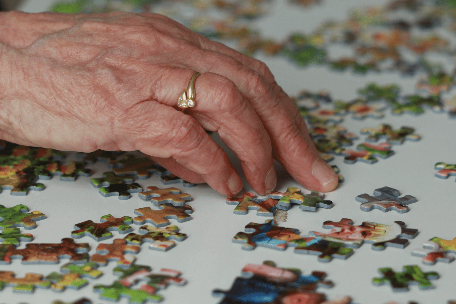 Senior woman with puzzle